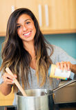 Beautiful Young Woman Cooking Dinner Royalty Free Stock Photography