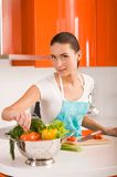 Beautiful young woman cooking in the kitchen Royalty Free Stock Photography