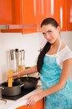 Beautiful young woman cooking in the kitchen Stock Image