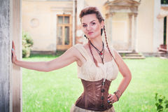Beautiful young woman in corset and shirt. Outdoor Stock Photos