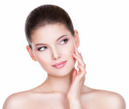 Beautiful young woman with cosmetic foundation on a skin. Portrait of beautiful young woman with cosmetic foundation on a skin - isolated on white background royalty free stock images