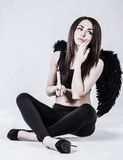 Beautiful young woman in a costume of the dark angel Stock Photography