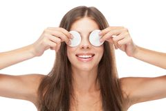 Beautiful young woman with cotton face pads Stock Images