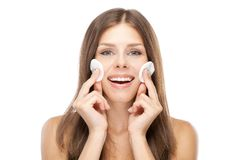 Beautiful young woman with cotton face pads Stock Image