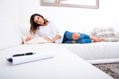 A beautiful young woman on the couch Royalty Free Stock Photo