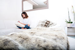 A beautiful young woman on the couch Royalty Free Stock Photography