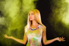 Beautiful young woman covered with colored powder Royalty Free Stock Photos