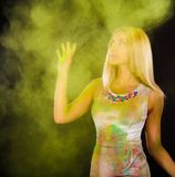 Beautiful young woman covered with colored powder Royalty Free Stock Image