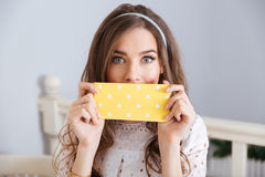 Beautiful young woman covered her face with napkin in cafe Royalty Free Stock Images