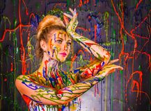 Beautiful young woman covered with paints Stock Photo
