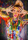 Beautiful young woman covered with paints Royalty Free Stock Image