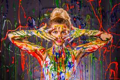Beautiful young woman covered with paints Royalty Free Stock Photos