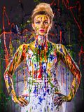 Beautiful young woman covered with paints Stock Photography