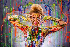 Beautiful young woman covered with paints Stock Images