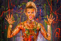 Beautiful young woman covered with paints Stock Image