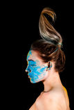 Beautiful young woman covered with yellow and blue paints Stock Image