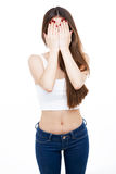 Beautiful young woman covering her face over white background. Royalty Free Stock Photo