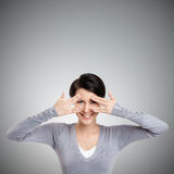 Beautiful young woman covers her eyes with hands Royalty Free Stock Photos
