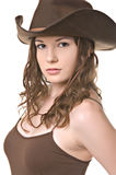 Beautiful young woman in cowboy hat stock photography