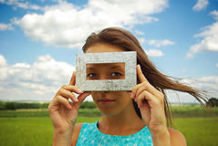 A beautiful young woman creates a frame royalty free stock photos