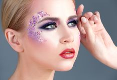 Beautiful young woman with creative makeup. On color background, closeup Royalty Free Stock Image
