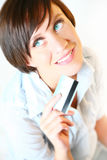 Beautiful young woman with credit card. Thinking what to buy royalty free stock image