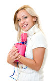 Beautiful young woman cuddles a gift Royalty Free Stock Photography