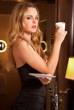 Beautiful young woman with a cup Stock Photo