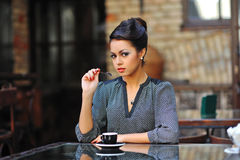 Beautiful young woman with a cup of coffee Stock Photography