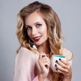 Beautiful young woman with cup of coffee Royalty Free Stock Photo