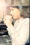 Beautiful young woman with a cup of coffee Stock Image