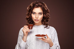 Beautiful young woman with a cup of coffee on the dark background. Beautiful young woman with cup of coffee on dark background Royalty Free Stock Photos