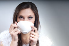 Beautiful Young Woman with cup drinking hot drink Stock Images