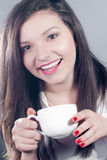 Beautiful young woman with a cup of hot drink Royalty Free Stock Photography