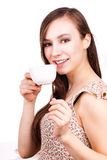 Beautiful young woman with cup of hot drink Stock Image