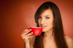 Beautiful young woman with cup of tea in her hands Royalty Free Stock Images