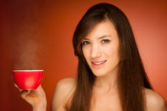 Beautiful young woman with cup of tea in her hands Royalty Free Stock Photos