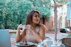 Beautiful young woman with cup of tea royalty free stock photos