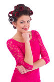 Beautiful young woman with curlers is happy Royalty Free Stock Images