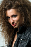 Beautiful young woman with curly hair Royalty Free Stock Images