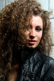 Beautiful young woman with curly hair Stock Images