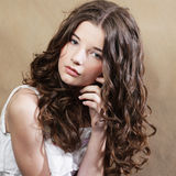 Beautiful young woman with curly hair. Royalty Free Stock Photography