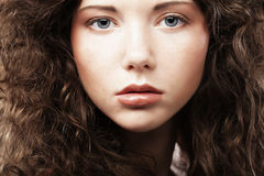 Beautiful young woman with curly hair. Stock Images