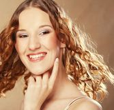 Beautiful young woman with curly hair. Royalty Free Stock Photo