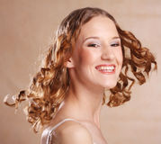 Beautiful young woman with curly hair. Stock Image