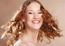 Beautiful young woman with curly hair. Stock Photos