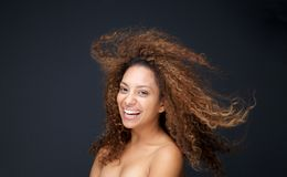 Beautiful young woman with curly hair laughing Royalty Free Stock Photography