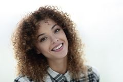 Portrait of a beautiful young woman with curly hair. Royalty Free Stock Image