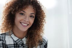 Portrait of a beautiful young woman with curly hair. Royalty Free Stock Photo