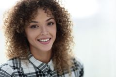 Portrait of a beautiful young woman with curly hair. Beautiful young woman with curly hair. Photo with blank space for text Royalty Free Stock Photos
